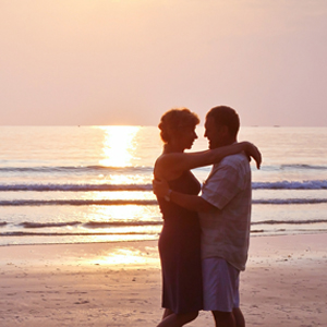 Couple at beach learning Maui Tantra