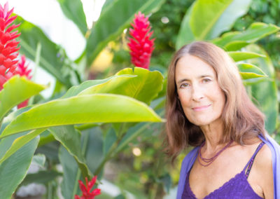 Sacred Healing Coach Deva Dasi with red ginger plants on Maui
